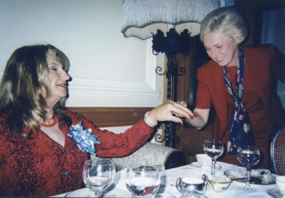 A proud Gayle extends her hand to a woman from a neighboring table who admired her engagement ring.