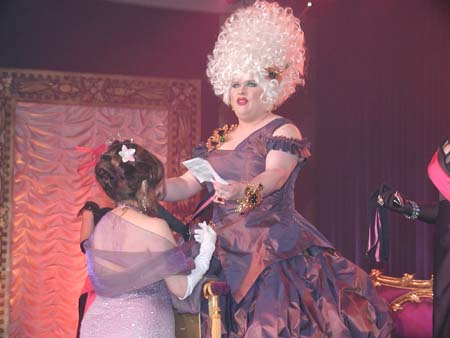 Miss Vera is knighted and receives a medal of honor as Empress XVIII Trai La Trash names her a Dame of the Court.