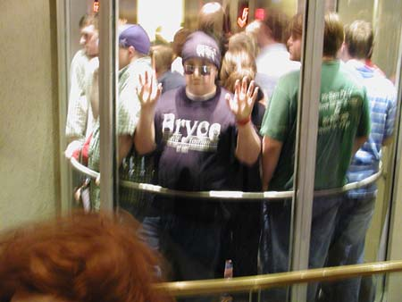 On the outside looking in. Hotel guests in the glass cage elevators.